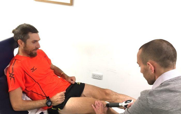 Paul Martelletti, Marathoner, receiving shockwave therapy