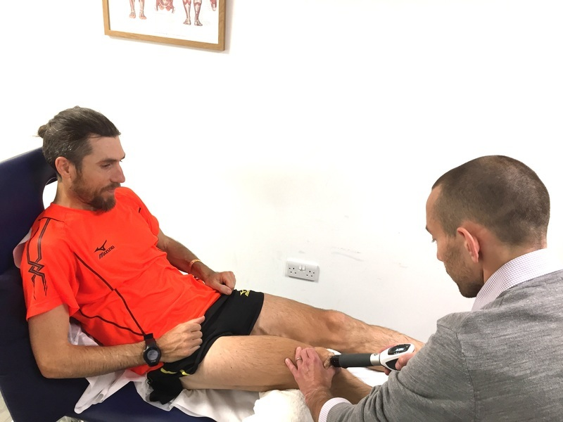Paul Martelletti, Marathoner, receiving shockwave therapy